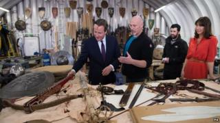 David Cameron and his wife Samantha were shown props and backdrops from the Game of Thrones TV series during their visit to Belfast