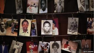 Family photos of victims of the 1994 Rwanda genocide (massacre) hang inside the Kigali Genocide Memorial Centre April 5, 2014 in Kigali, Rwanda