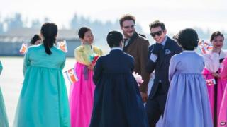 Still from The Interview showing Seth Rogen and James Franco in character arriving in Pyongyang - Columbia Pictures/Sony