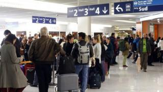 Passengers queuing at a check-in desk at Orly airport,