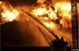 Firefighters try to extinguish a fire at a petrochemical plant in Zhangzhou, Fujian province 7 April 2015