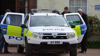 Police vehicle being loaded with boxes outside the Eagle Medical Practice in Alderney