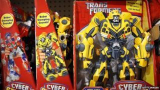 Transformers toys on a shelf