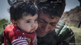 Kurdish Peshmerga forces help people from Iraq's Yazidi minority on 8 April, 2015