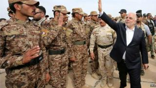 Handout picture of Iraqi PM greeting Sunni volunteers in Anbar province on 8 April 2015