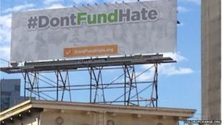 Billboard with slogan #DontFundMe