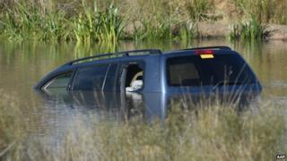 A 4WD lays submerged in Lake Gladman, Melbourne, on 9 April 2015