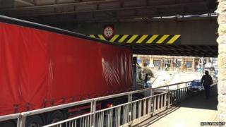 Lorry hits bridge