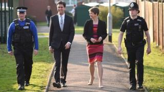 Labour leader Ed Miliband and Shadow Home Secretary Yvette Cooper, with officers from Ollerton Police Station, Nottinghamshire