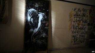 A mural of a crying figure by British street graffiti artist Banksy in the Gaza Strip, 1 April 2015