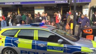 Passengers outside Stockwell Tube station