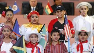 Children representing the native dress of North and South American countries perform during the inauguration ceremony of the Summit of the Americas in Panama City on 10 April 2015
