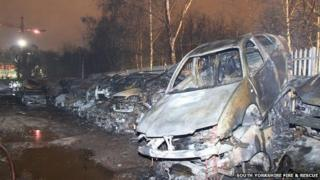 Burnt out cars at Deep Lane scrap yard in Sheffield