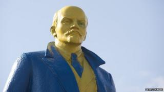 A statue of Lenin painted in blue and yellow