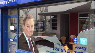 A plate glass window at the office of Danny Kinahan in Ballyclare was smashed