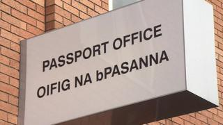 Irish passport office sign, written both in English and in the Irish language