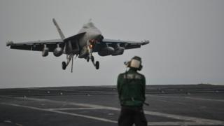 F/A-18F fighter landing on USS Carl Vinson