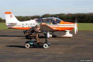 Colin Furze races his mobility scooter against a plane