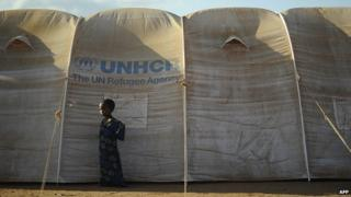 A young Somali refugee stands next to her family's shelter at the new Ifo-extension in Dadaab on 31 July 2011.