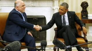 Iraq's Prime Minister Haider al-Abadi (L) and U.S. President Barack Obama shake hands after their bilateral meeting in the Oval Office at the White House in Washington on 14 April 2015.