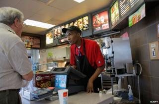 A man working at McDonald's