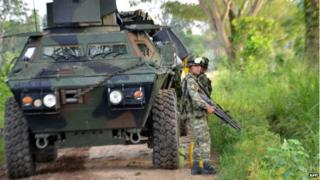 A Colombian soldier stands guard in the town of Tame, Arauca department, 25 August 2013