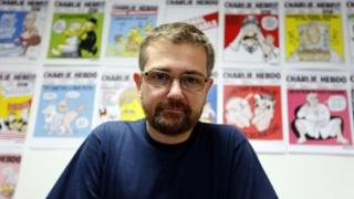 Charlie Hebdo's late editor, Charb, December 2012 photo