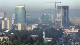 A construction crane stands among office buildings over the city centre in Addis Ababa, Ethiopia - March 2013