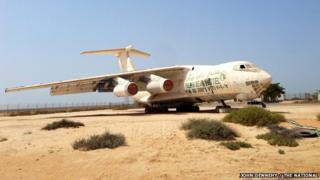 An Ilyushin 76 Russian-made cargo plane, once owned by former arms dealer Victor Bout, sits in a lot on the site of the old Umm al Qaiwain airfield