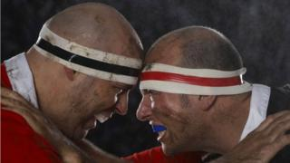 Rugby players wearing mouthguards