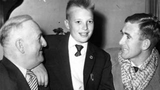 Bengt Jonasson, centre, who was Northern Ireland's adopted mascot at the 1958 World Cup, with trainer Gerry Morgan, left and captain Danny Blanchflower