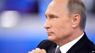 Russian President Vladimir Putin listens to a question during his annual televised phone-in with the nation in central Moscow on April 16, 2015