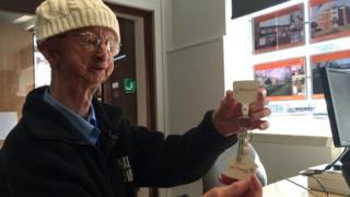 Alan Barnes with the key to his new home