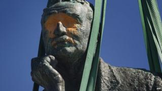 Cecil Rhodes statue at Cape Town University with paint blinding out the eyes, South Africa - April 2015