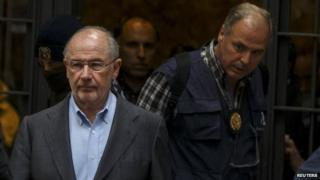 Rodrigo Rato is escorted from his home by investigators, Madrid, 16 April 2015
