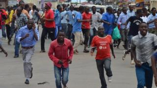 protesters running away from police during protests in Bujumbura