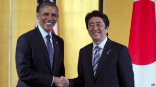 In this April 24, 2014 file photo, US President Barack Obama, left, and Japanese Prime Minister Shinzo Abe shake hands as they arrive to participate in a bilateral meeting at the Akasaka State Guest House in Tokyo