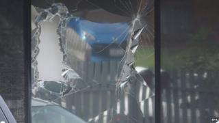 A broken window from a police raid at a house in Hallam, a suburb of Melbourne, where police made one of several arrest during terror raids in Melbourne, Australia, 18 April 2015