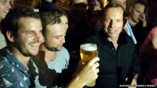 Australian Prime Minister Tony Abbott before downing a pint of beer in Sydney - April 18, 2015