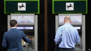 File photo dated 28/10/14 of members of the public using cash machines at a branch of Lloyds Bank in the City of London