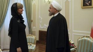 In this photo released by the official website of the office of the Iranian Presidency, Iran's President Hassan Rouhani greets Australian Foreign Minister Julie Bishop at the start of their meeting in Tehran, Iran on 18, April 2015.