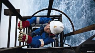 Petrofac employee climbing ladder