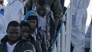 Rescued migrants with Italian coastguard