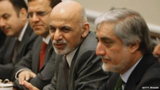 Afghanistan President Ashraf Ghani (L) and Afghanistan Chief Executive Officer Abdullah Abdulla (R) attend a bipartisan meeting with members of the House leadership on Capitol Hill March 25, 2015 in Washington, DC.