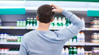 Man choosing milk