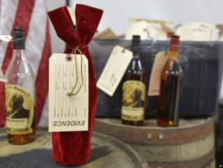 Evidence tags affixed to bottles of bourbon