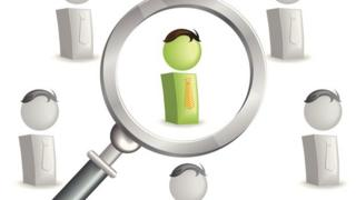 Magnifying glass and figures