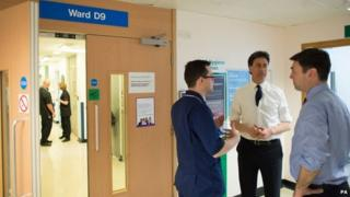 Ed Miliband and Andy Burnham during a visit to the oncology unit of the Addenbrooke's Hospital in Cambridge