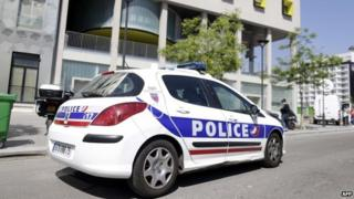 A police vehicle is parked outside the student residence where an It student, suspected of planning a church attack in France, lived in Paris on April 22, 2015