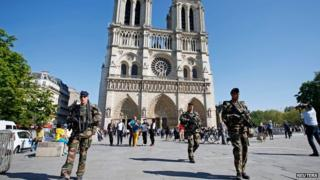 French police patrol outside Notre Dame Cathedral on 22 April 2015